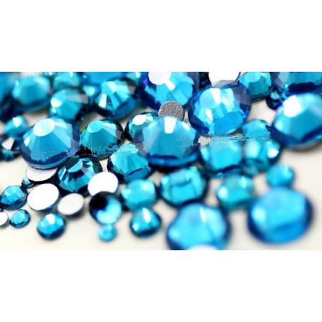 Stikliniai PEACOCK BLUE akmenukai 100vnt. MIX dydžiai